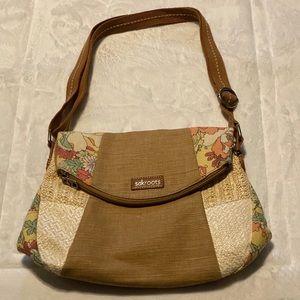 Sak Roots artist circle fold over messenger bag